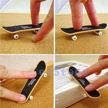 4 Piece a Set Mini Finger Board Skateboards Kids  Fascinating Toys(China (Mainland))