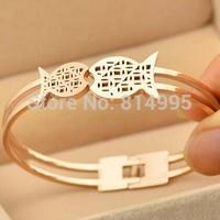 14k rose gold plsted  titanium steel fish bangles