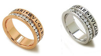 Brand wedding rings.18 k gold plating & many rhinestone & carved English letters ring.Free shipping + gifts.2 color optional.