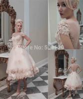 Fashionable 2014 vestidos de noiva Sheer Bateau Lace Applique Ball Gown Button Tea Length Short Sleeve Salomon Wedding Dresses