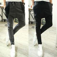 Free Shipping Korean Fashion Men's PU Faux Leather Splice Harem Jogging Pants Casual Slim Fit Trousers Slacks