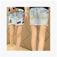 2014 New Korean Retro Women Patch Significantly Thin Denim Skirt Bust Skirt Female Summer Fashion High Quality