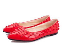 2014 new European and American Warren Red Bottom spikes Rivets pointed flat shoes women shallow mouth single shoes