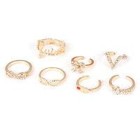 2 sets/lot(7pcs/set)Hot Sale 2014 bulgary Female Gold Color 8 cross Bow Shape rhinestone  Design  Korean Rings free shipping