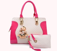 The new European and American fashion handbags trend hit color retro hand bag lady