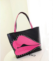 Free shipping large carpacity PU leather women's handbags Fashion 0.5kg Personality sexy Lip with Rivet shoulder bag