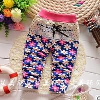 The autumn of 2014 new Korean girl child with sun flower dot knit pantsA109