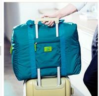 Free shipping men's travel bags nylon buffle handbag solid storage bag luggage bags