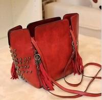 2014 new fashion women bucket rivet fringed shoulder bag retro bag diagonal handbags,black ,red ,beige.3057