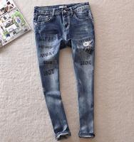 2014 New loose hole stretch denim wear white pants female Korean Hitz thin straight jeans tide