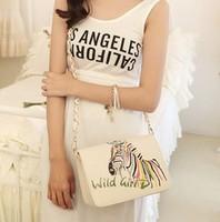 Free shipping 2014 autumn winter embroidery zebra women bag fashion metal chain women messenger bags shoulder bags
