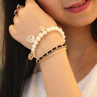 New hot Korean Fashion Multi-chain Stars antiwar Crown rhinestone skull pendants pearl bracelet jewelry for women 2014 PT36