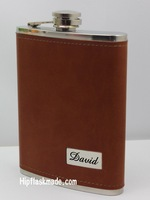 Your Named show on the  8 oz stainless steel leather  hip flask with brown  color