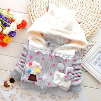 Hot new style of autumn and winter 2014 baby girls cartoon rabbit ears jacket pocket round penalty hooded sweatshirt jacket.
