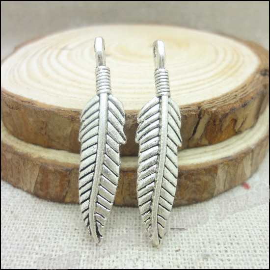 Popular items for metal feather charm on Etsy