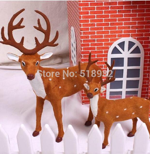 O envio gratuito de produtos de Natal veados simulação cervo Pai Natal veados forjado ferro 53 centímetros X25 cm e 37 centímetros X22 cm(China (Mainland))