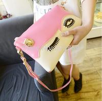 The new printed hand big eyes inclined cartoon female bag