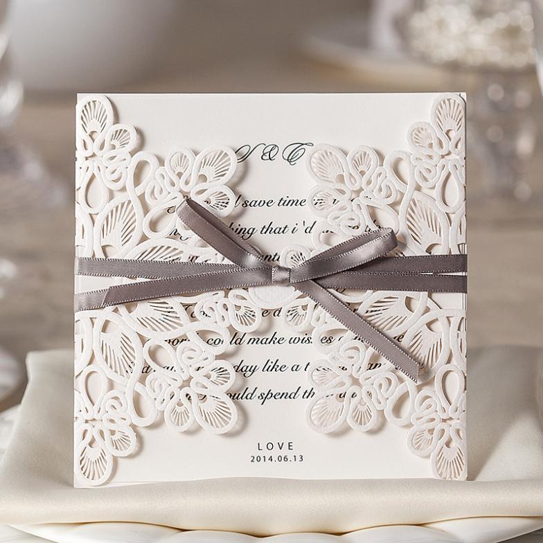 30pcs/Lot Silver Ribbon Bow Decoration Lace Flower Hollow Decoration Wedding Invitation Card With Envelope Laser Cut Invitation(China (Mainland))