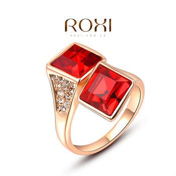 Roxi элегантное женское кольцо ручной работы, выполнено из розового золота с трех разовым золотым напылением, украшенное сверкающими австрийскими кристаллами и двумя красными камнями (швейцарский цирконий), размеры 6-8