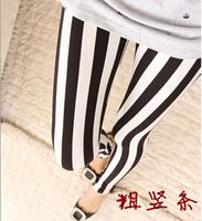 2014 New Fashion Black and white vertical striped women leggings Milk silk tenths pants Free Shipping