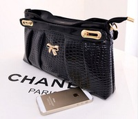 2014 new candy-colored minimalist trend lady bag, a portable. Shoulder. Diagonal multifunction ladies fashion boutique bags