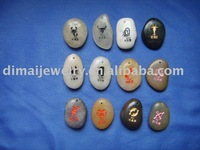 Engraved natural stones with letters