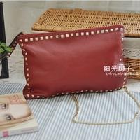 Fashion fashion rivet metal chain genuine leather first layer of cowhide day women's envelope clutch bag handbag one shoulder