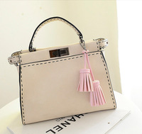 Wholesale 2014 new European and American big-name fashion candy color tassel pendant child fashion bat bag a generation of fat
