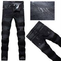 2014 Lastest Personalized pocket  skull men's jeans denim trousers