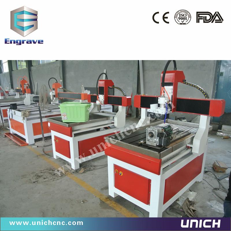 Multifunction!!!unich 600*900mm cnc router machine&baseball bat cnc wood turning lathe(China (Mainland))