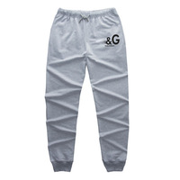 2014 new arrival free shipping embroidered logo applique fashion men sports pants casual trousers men straight jeans