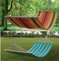 Hot sales 200*80cm Outdoor single man hammock plain stripe canvas hammock with wooden stick sleeping hammock outdoor hammocks