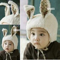 Hot sale 2014Children's rabbit ear modelling earmuffs autumn/winter hats children hedging cap Boys and girls cap lovely children