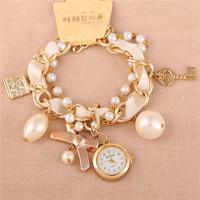 Hot Listing Korean New Smart Leisure Skeleton Key Pendant Pearl Bracelet Watches,Fashion Luxury Women Leisure Bow Quartz Watches