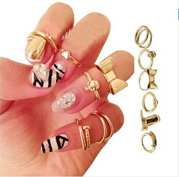 7Pcs/Set Vogue Gold Skull Bowknot Love Heart Design Simple Nail Band Mid Finger Rings Set Fashion Women Jewelry(China (Mainland))