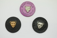 Best style round PU label with tiger metal