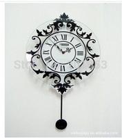 Paired mute swinging pendulum clock/European fashion creative personality sitting room hanging bracket clock clocks