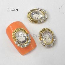 10pcs 3d alloy gold fashionable laptop nail art glitters for women tips SL-209(China (Mainland))