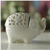 Fashion home decor ceramic aroma burner elephant shape decorative pierced work  white ceramic crafts