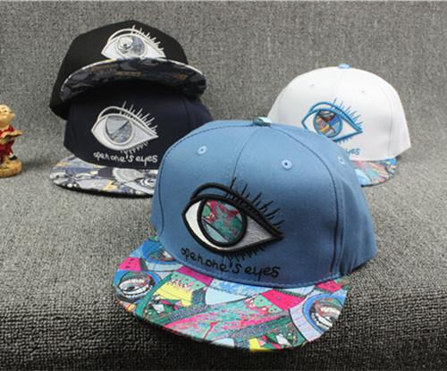2015 brand big eyes hiphop baseball cap casual graffiti bone snapback female male gorras casquette chapeau for women men(China (Mainland))