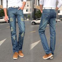 men Hole paint slim straight jeans male splash-ink denim trousers