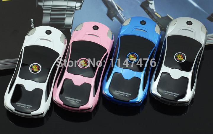 Free shipping F8 car cell phone Dual SIM slider Camera Bluetooth FM Radio car key phone mini colorfut neon light mobile phone(China (Mainland))