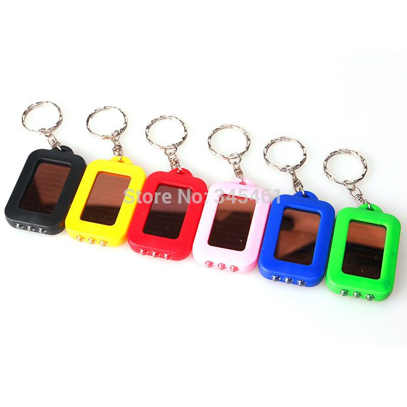 10pcs 3led Solar flashlight keychain Mini Flashlight Low power consumption Plastic 4 color Outdoor Rechargeable Keychain Light(China (Mainland))