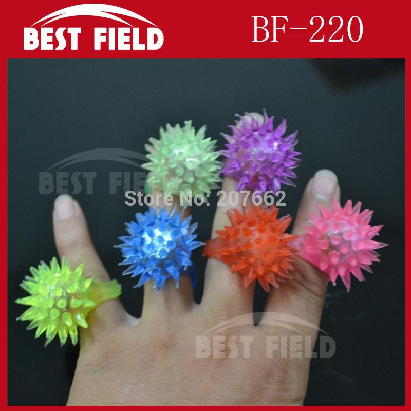 Free Shipping 72pcs/lot 3*4CM led thorn finger ring Led Rubber Finger Light Beam Ring Torch novelty finger light Party Wedding(China (Mainland))