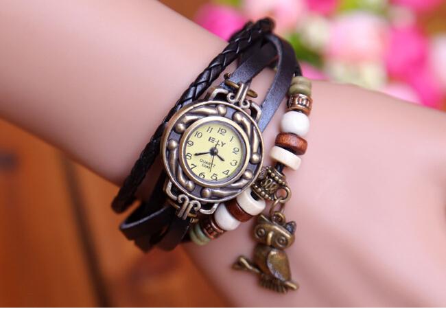 Female owl pendant vintage watches leather ladies leisure quartz bracelet watches(China (Mainland))