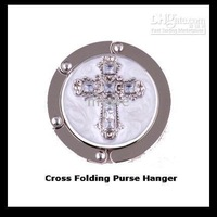 Folding Bag Hanger Hook Features a Clear Crystal Embellished Cross On a white Background,with Pouch