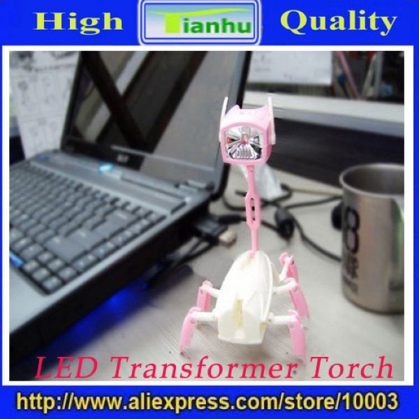 latest fashion Novelty Product multi-functional torch Led Flashlight Torch Transformer Light Lamp Robot,gift,hot selling,cheap(China (Mainland))
