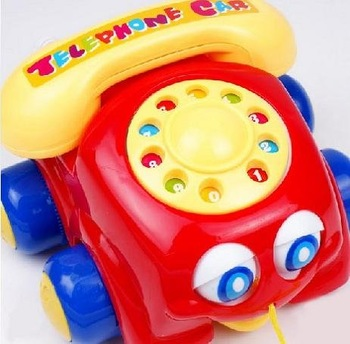 It is both telephone and car! with music, ring, rope, big eyes, four wheels. toys 2011, new hot toys 2011 for kids
