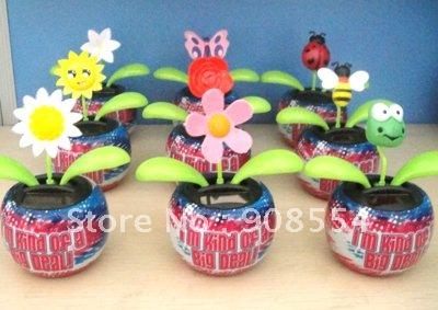 Wholesale 10Pcs Per Lot Free Shipping Novelty toys Magic Cute Flip Flap Happy Solar Dancing Flower(China (Mainland))