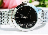 Free shipping Quartz pointer table supply contracted man joker leisure steel belt watch new supply of 144545